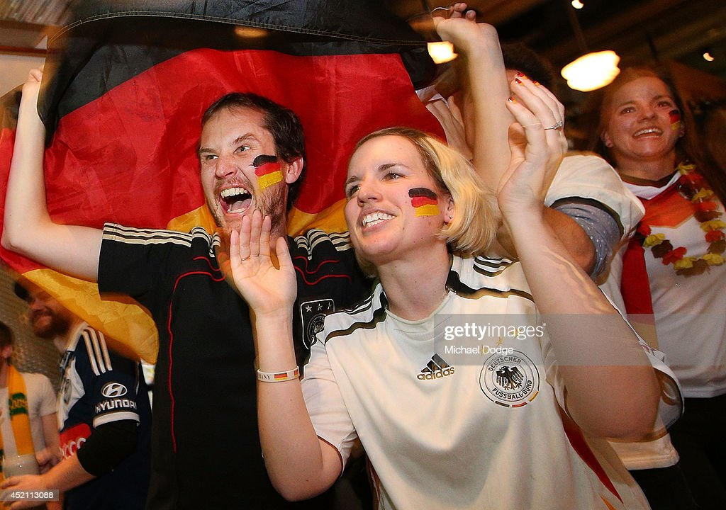 German fans at Hophaus celebrate the win while watching the 2014 FIFA World Cup Final match between Germany and Argentina on July 14, 2014 in Melbourne, Australia.