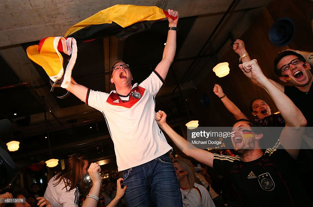 German fans at Hophaus celebrate the winning goal while watching the 2014 FIFA World Cup Final match between Germany and Argentina on July 14, 2014 in Melbourne, Australia.