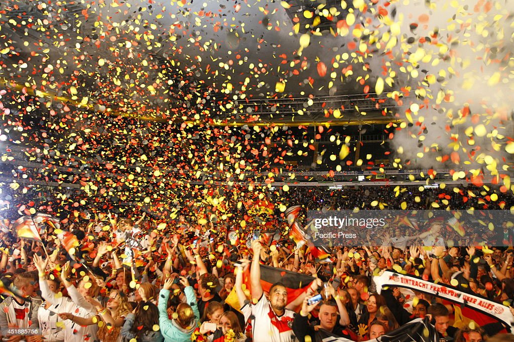 ARENA, FRANKFURT, HESSE, GERMANY - : German fans celebrate their victory with huge amounts of confetti. 21,000 fans celebrated the victory of Germany over Brazil by 7 goals to 1 in the 2014 FIFA Soccer World Cup Semi Final in Frankfurt's Commerzbank-Arena.