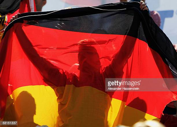 German fans hold up a German flag during the Bronze Medal Match between Kjell Schneider and Julius Brink of Germany against Marvin Polte and Thorsten...