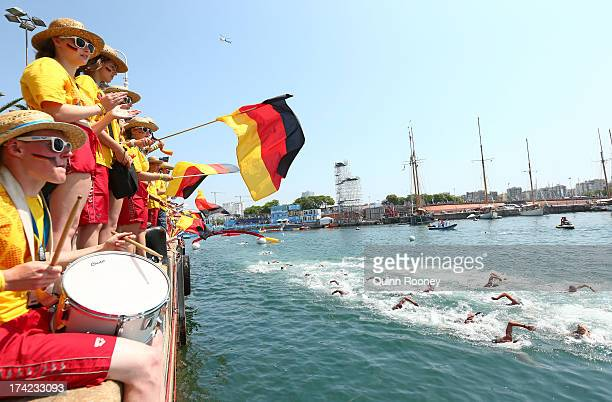 German fans show their support as competitors swim in the Open Water Swimming Men's 10k race on day three of the 15th FINA World Championships at...