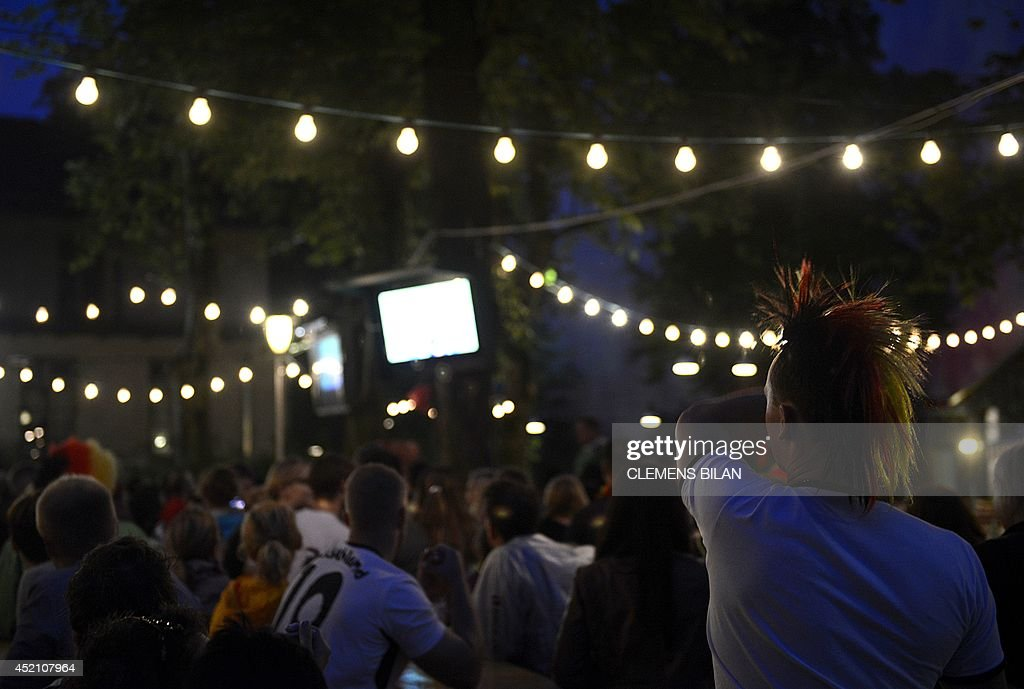 German fans watch in the Prater beer garden in Berlin on July 13, 2014 in front of a big screen displaying the World Cup the Worthe FIFA World Cup 2014 final football match Germany vs Argentina played in Brazil.