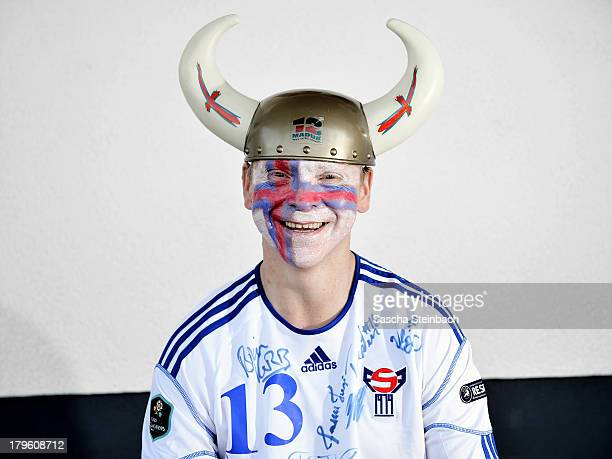German Faroe Islands football fan Martin Schuermann poses in the colors of his favourite team on September 5 2013 in Lennestadt Germany