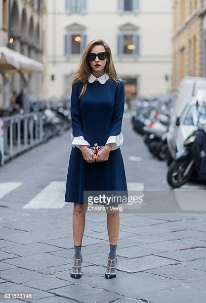 German fashion blogger and model Alexandra Lapp is wearing navy blue kneelength shirt dress in flared cut with removable wavy Peter Pan collar and...