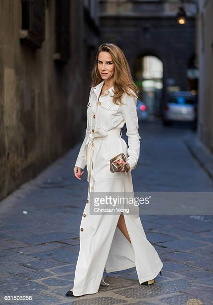 German fashion blogger and model Alexandra Lapp is wearing trenchcoat dress in white with golden buttons waisted with a belt from Talbot Runhof...