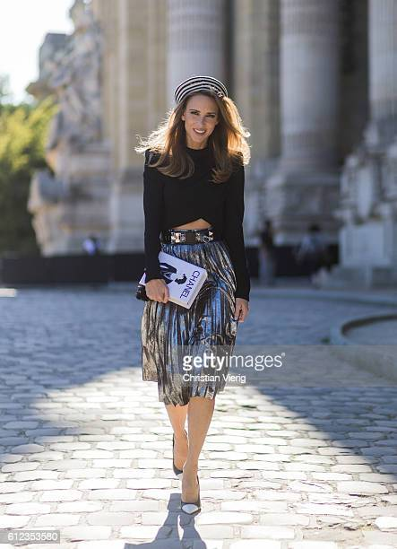 German fashion blogger and model Alexandra Lapp wearing a black sweater from Balmain pleated skirt from Zara Saint Laurent pumps Gucci hat and...