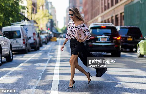 German Fashion Blogger and Model Alexandra Lapp wearing a black Tigha skirt Jadicted blouse Chloe bag Celine sunglasses and Christian Louboutin pumps...