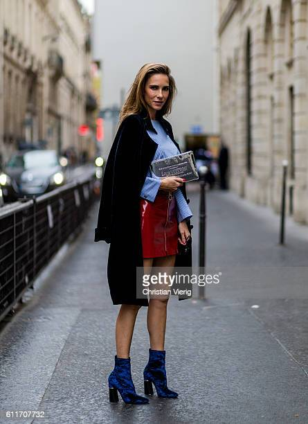 German fashion blogger and model Alexandra Lapp wearing a red skirt and button shirt from Zara blue Phillip Lim shoes Steffen Schraut black coat...