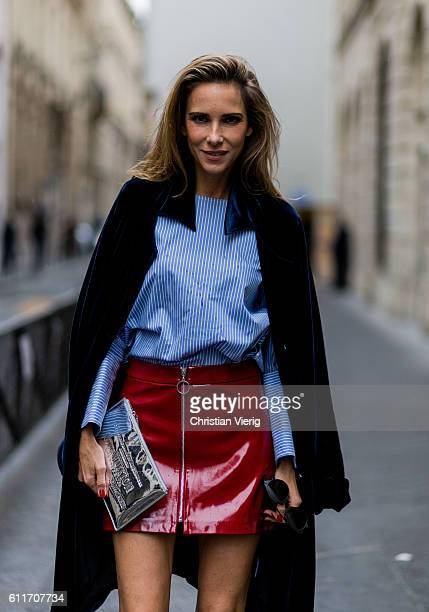 German fashion blogger and model Alexandra Lapp wearing a red skirt and button shirt from Zara Steffen Schraut black coat silver clutch from Louis...