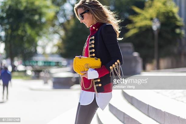 German fashion blogger and model Alexandra Lapp wearing black leather pants from SET Celine button shirt red sweater and jacket from Balmain Celine...