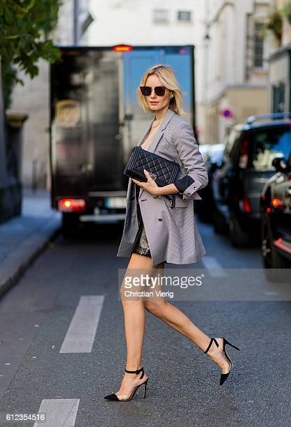 German fashion blogger Lisa Hahnbueck wearing Blazer Guess Knit Acne Studios Skirt Patent Asymmetric Leather Skirt Mango Heels Plexi Heels Gianvito...