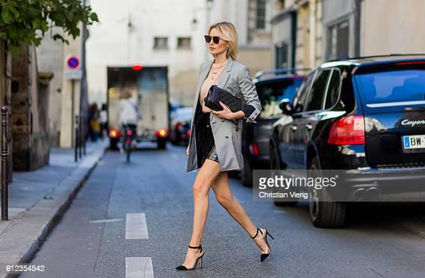 German fashion blogger Lisa Hahnbueck wearing Blazer Guess Knit Acne Studios Skirt Patent Asymmetric Leather Skirt Mango Heels Plexi Heels Gianvito...