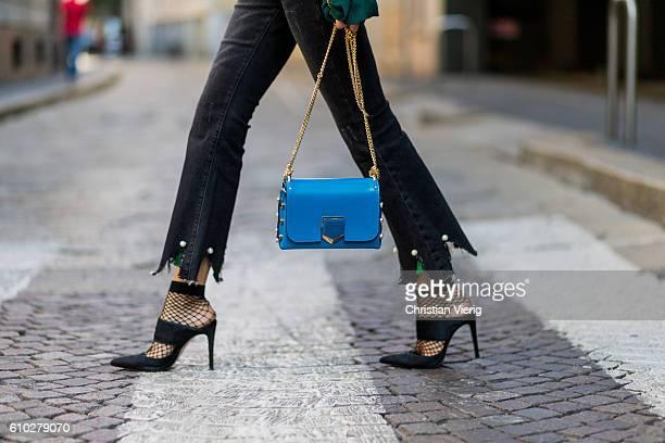 German fashion blogger Lisa Hahnbueck wearing dark black Storets Cropped Flare Jeans with Pearl Tassel Details Jimmy Choo Lockett Petite Bag in Blue...