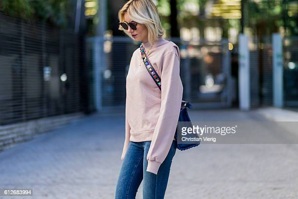 German fashion blogger Lisa Hahnbueck wearing pink OffWhite Backless Sweatshirt JBrand Highwaist Jeans blue FENDI Pekaboo Bag on October 4 2016 in...