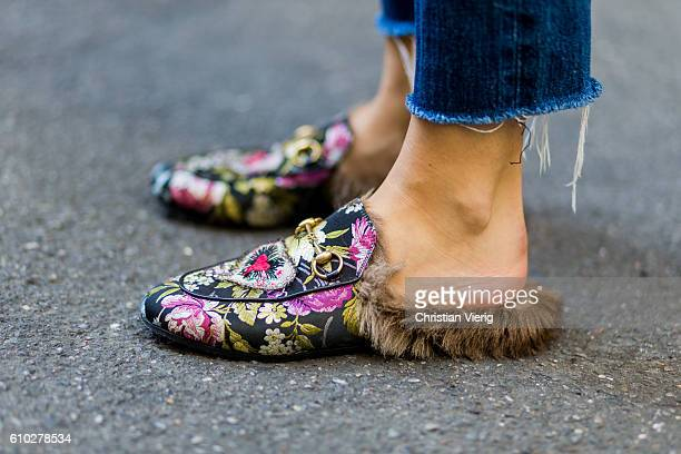 German fashion blogger Lisa Hahnbueck wearing shoes Gucci Brocade Princetown Loafer during Milan Fashion Week Spring/Summer 2017 on September 24 2016...
