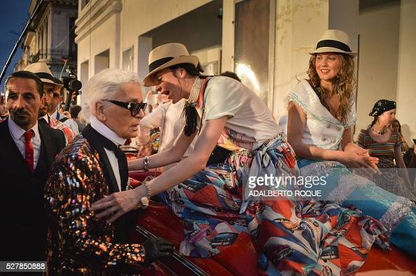 German fashion designer artist and photographer Karl Lagerfeld attends his performance for Chanel at the Prado promenade in Havana on May 3 2016 /...