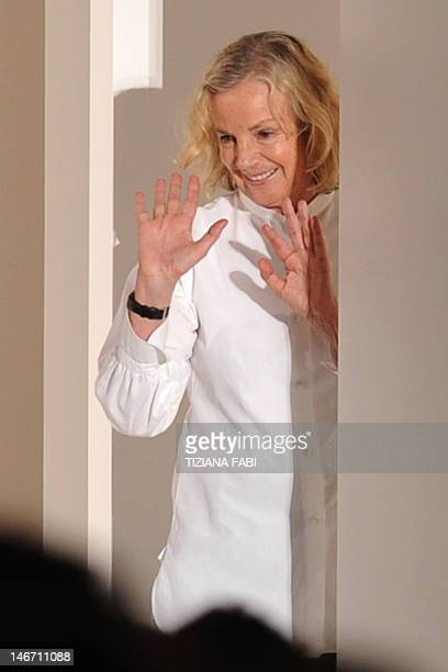 German fashion designer Jil Sander acknowledges the audience at the end of the SpringSummer 2013 Menswear collection on June 23 2012 during the Men's...