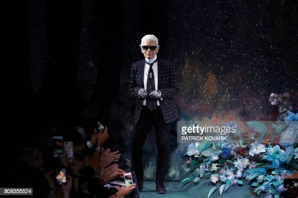 TOPSHOT German fashion designer Karl Lagerfeld acknowledges the audience at the end of Fendi 20172018 fall/winter Haute Couture collection in Paris...