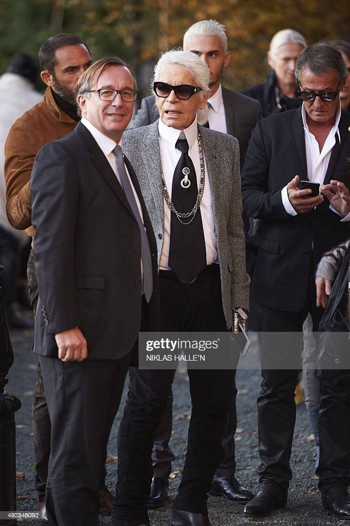 German fashion designer <a gi-track='captionPersonalityLinkClicked' href=/galleries/search?phrase=Karl+Lagerfeld+-+Fashion+Designer&family=editorial&specificpeople=4330565 ng-click='$event.stopPropagation()'>Karl Lagerfeld</a> (C), head designer and creative director of French fashion house Chanel arrives for a press-view of 'Mademoiselle Privé', a joint exhibition presented by CHANEL and <a gi-track='captionPersonalityLinkClicked' href=/galleries/search?phrase=Karl+Lagerfeld+-+Fashion+Designer&family=editorial&specificpeople=4330565 ng-click='$event.stopPropagation()'>Karl Lagerfeld</a>, at the Saatchi Gallery in west London, on October 12, 2015. The exhibition Mademoiselle Privé will aim to show the fashion house's journey, from designers Gabrielle Chanel to <a gi-track='captionPersonalityLinkClicked' href=/galleries/search?phrase=Karl+Lagerfeld+-+Fashion+Designer&family=editorial&specificpeople=4330565 ng-click='$event.stopPropagation()'>Karl Lagerfeld</a>. AFP PHOTO / NIKLAS HALLE'N