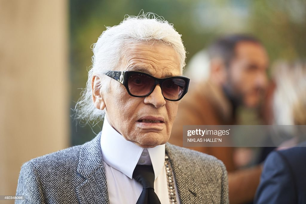 German fashion designer <a gi-track='captionPersonalityLinkClicked' href=/galleries/search?phrase=Karl+Lagerfeld+-+Fashion+Designer&family=editorial&specificpeople=4330565 ng-click='$event.stopPropagation()'>Karl Lagerfeld</a>, head designer and creative director of French fashion house Chanel arrives for a press-view of 'Mademoiselle Privé', a joint exhibition presented by CHANEL and <a gi-track='captionPersonalityLinkClicked' href=/galleries/search?phrase=Karl+Lagerfeld+-+Fashion+Designer&family=editorial&specificpeople=4330565 ng-click='$event.stopPropagation()'>Karl Lagerfeld</a>, at the Saatchi Gallery in west London, on October 12, 2015. The exhibition Mademoiselle Privé will aim to show the fashion house's journey, from designers Gabrielle Chanel to <a gi-track='captionPersonalityLinkClicked' href=/galleries/search?phrase=Karl+Lagerfeld+-+Fashion+Designer&family=editorial&specificpeople=4330565 ng-click='$event.stopPropagation()'>Karl Lagerfeld</a>. AFP PHOTO / NIKLAS HALLE'N
