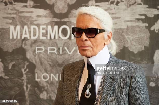 German fashion designer Karl Lagerfeld head designer and creative director of French fashion house Chanel poses for a photograph as he arrives for a...