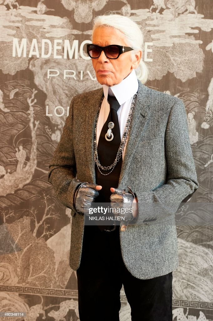 German fashion designer <a gi-track='captionPersonalityLinkClicked' href=/galleries/search?phrase=Karl+Lagerfeld+-+Fashion+Designer&family=editorial&specificpeople=4330565 ng-click='$event.stopPropagation()'>Karl Lagerfeld</a>, head designer and creative director of French fashion house Chanel poses for a photograph as he arrives for a press-view of 'Mademoiselle Privé', a joint exhibition presented by CHANEL and <a gi-track='captionPersonalityLinkClicked' href=/galleries/search?phrase=Karl+Lagerfeld+-+Fashion+Designer&family=editorial&specificpeople=4330565 ng-click='$event.stopPropagation()'>Karl Lagerfeld</a>, at the Saatchi Gallery in west London, on October 12, 2015. The exhibition Mademoiselle Privé will aim to show the fashion house's journey, from designers Gabrielle Chanel to <a gi-track='captionPersonalityLinkClicked' href=/galleries/search?phrase=Karl+Lagerfeld+-+Fashion+Designer&family=editorial&specificpeople=4330565 ng-click='$event.stopPropagation()'>Karl Lagerfeld</a>. AFP PHOTO / NIKLAS HALLE'N