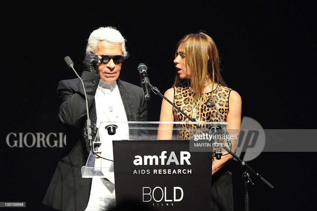 German fashion designer Karl Lagerfeld leads an auction at amfAR's Cinema Against Aids 2010 benefit gala on May 20, 2010 in Antibes, southeastern France.