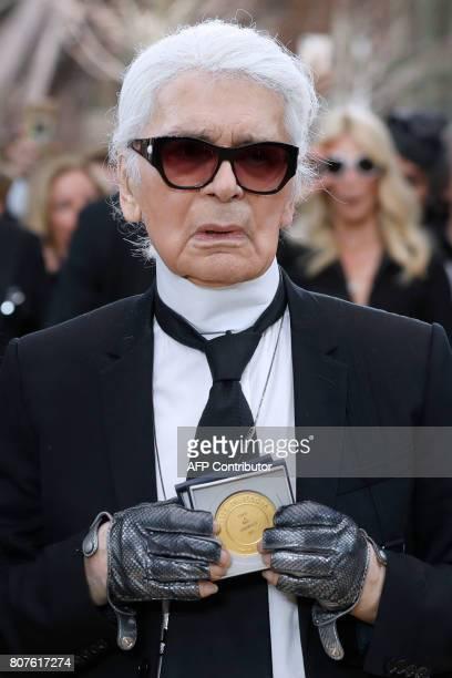 German fashion designer Karl Lagerfeld receives the Grand Vermeil De La Ville De Paris medal after Chanel 20172018 fall/winter Haute Couture...