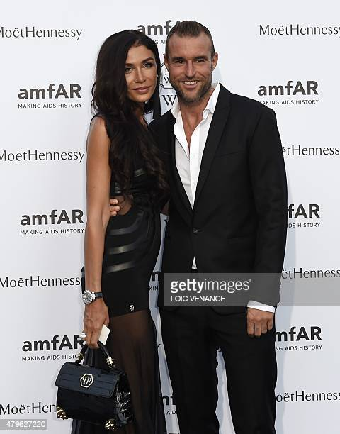 German fashion designer Philipp Plein and guest arrive for the amfAR dinner on the sidelines of the Paris fashion week in Paris on July 5 2015 AFP...
