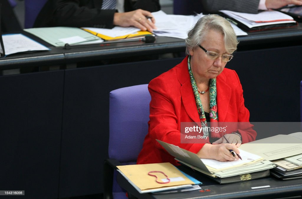German Federal Education Minister Annette Schavan writes in a folder during a government declaration by German Chancellor Angela Merkel in the Bundestag prior to a European Council meeting in Brussels on October 18, 2012 in Berlin, Germany. European Union leaders are expected to focus on economic and monetary policies as they gather for the two-day Autumn meeting starting today in Brussels.