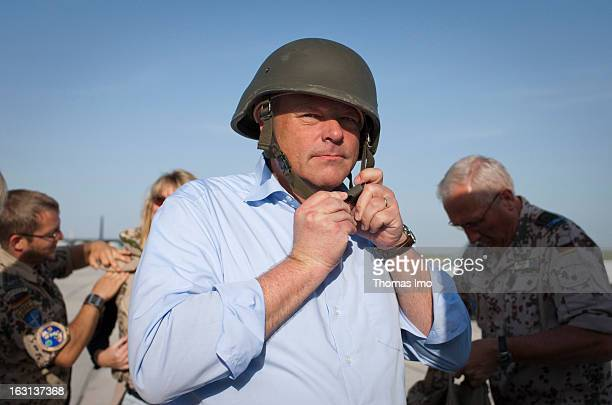 German Federal Minister for Economic Cooperation and Development Dirk Niebel member of the Free Democraty Party gets a steel helmet in Termez before...