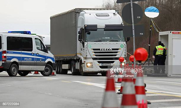 German federal police control cars on the A3 highway near the border to Austria on a section used by arriving migrants and refugees on January 28...