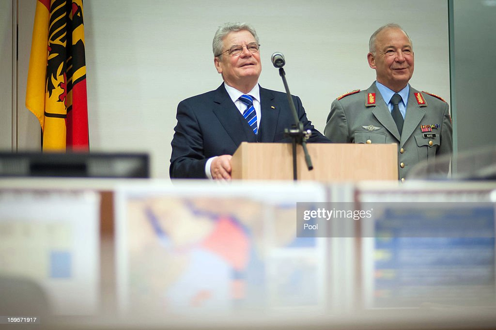 German Federal President <a gi-track='captionPersonalityLinkClicked' href=/galleries/search?phrase=Joachim+Gauck&family=editorial&specificpeople=2077888 ng-click='$event.stopPropagation()'>Joachim Gauck</a> and commander of the operational command of the armed forces, Lieutenant General Rainer Glatz, participate in a videoconference with the German soldiers in around the world, on January 16, 2013 in Potsdam, Germany.