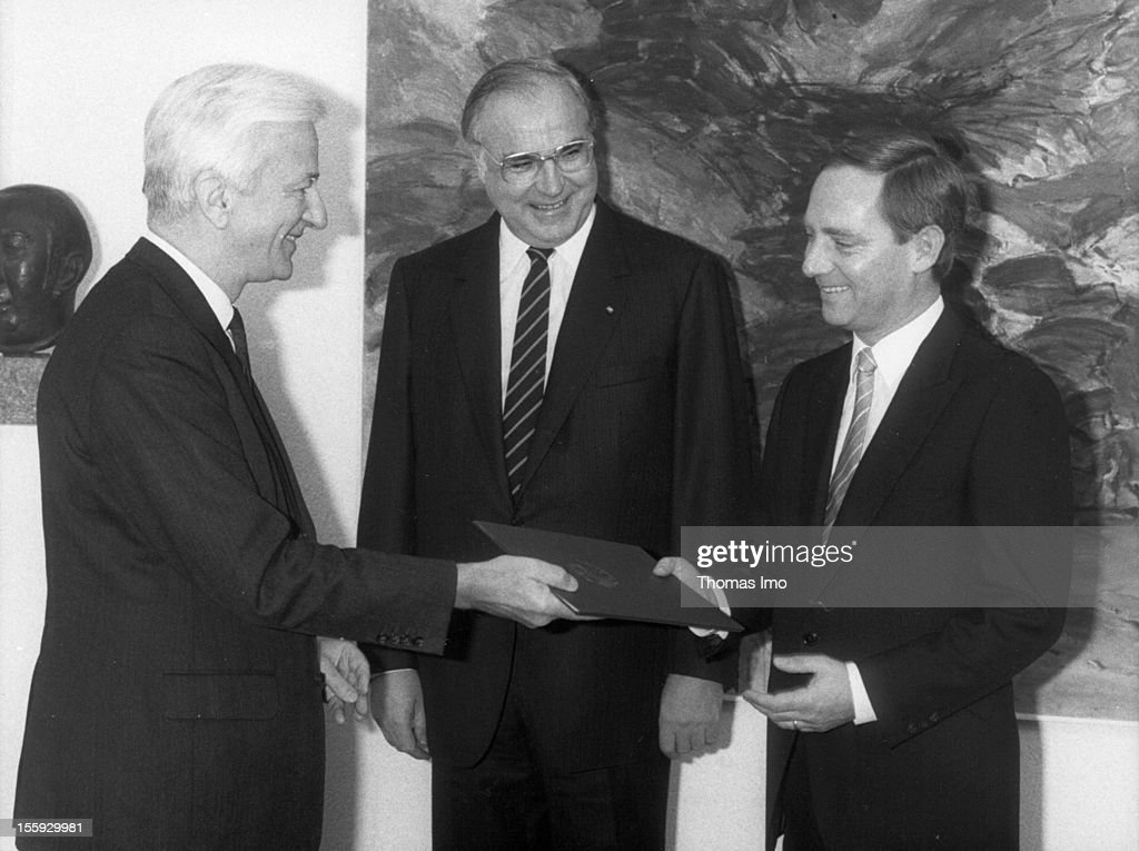 German Federal President Richard von Weizsaecker presenting Wolfgang Schaeuble with his certificate of appointment of Federal Minister of particular task, German Federal Chancellor <a gi-track='captionPersonalityLinkClicked' href=/galleries/search?phrase=Helmut+Kohl&family=editorial&specificpeople=202518 ng-click='$event.stopPropagation()'>Helmut Kohl</a> standing in the middle, November 15, 1984, Bonn, Germany.