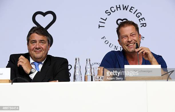German Federal Vice Chancellor Sigmar Gabriel and actor Til Schweiger attend a press conference in connection with the launch of the Til Shweiger...