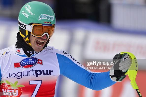 German Felix Neureuther celebrates after winning the Men Slalom race at the Alpine ski World Cup finals on March 17 2013 in Lenzerheide AFP PHOTO /...