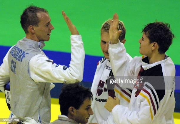 German fencing team members from left Ralf Bissdorf Christian Schlechtweg Lars Schache and Dominik Behr exult 31 October 2001 after beating Austria...