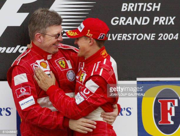 German Ferrari driver Michael Schumacher is congratulated by Ferrari Technical manager Ross Brawn on the podium of the Silverstone racetrack after...