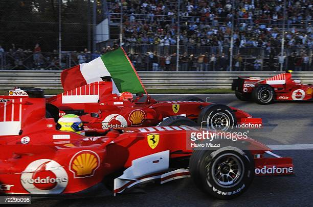 German Ferrari driver Michael Schumacher performs in a show race with his teammates during the Ferrari Days on October 29 2006 in Monza Italy...