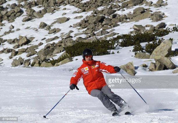 German Ferrari driver Michael Schumacher skies in the winter resort of Madonna di Campiglio in the Dolomites area northern Italy 13 January 2005...