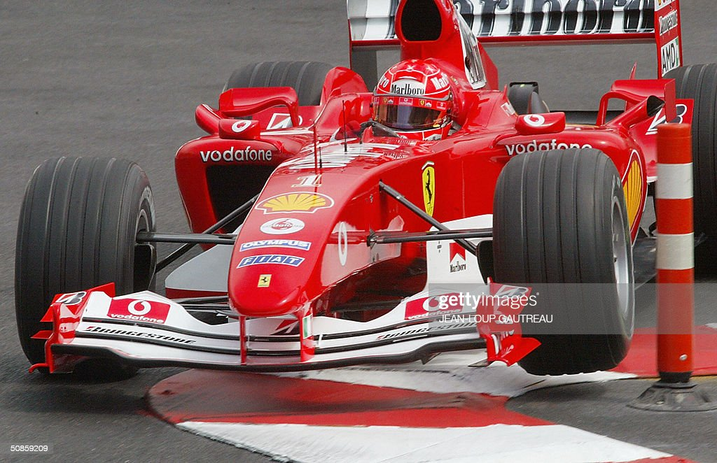 German Ferrari driver Michael Schumacher steers his car on the Monte-Carlo racetrack during the first free practice session three days before the Monaco Grand Prix, 20 May 2004 in Monaco.