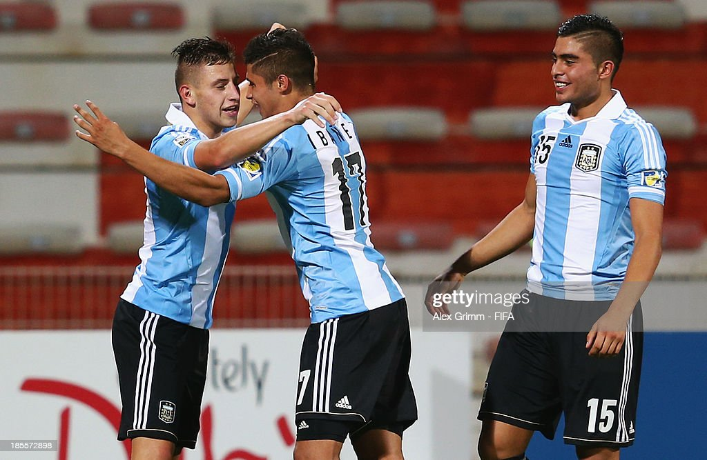 German Ferreyra of Argentina celebrates his team's second goal with team mates Joaquin Ibanez and Rodrigo Moreira (L-R) during the FIFA U-17 World Cup UAE 2013 Group E match between Argentina and Austria at Al Rashid Stadium on October 22, 2013 in Dubai, United Arab Emirates.
