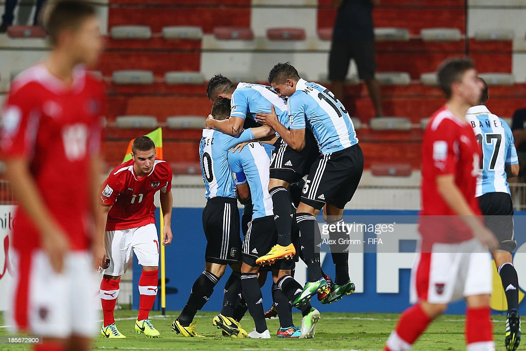 German Ferreyra of Argentina celebrates his team's second goal with team mates during the FIFA U-17 World Cup UAE 2013 Group E match between Argentina and Austria at Al Rashid Stadium on October 22, 2013 in Dubai, United Arab Emirates.