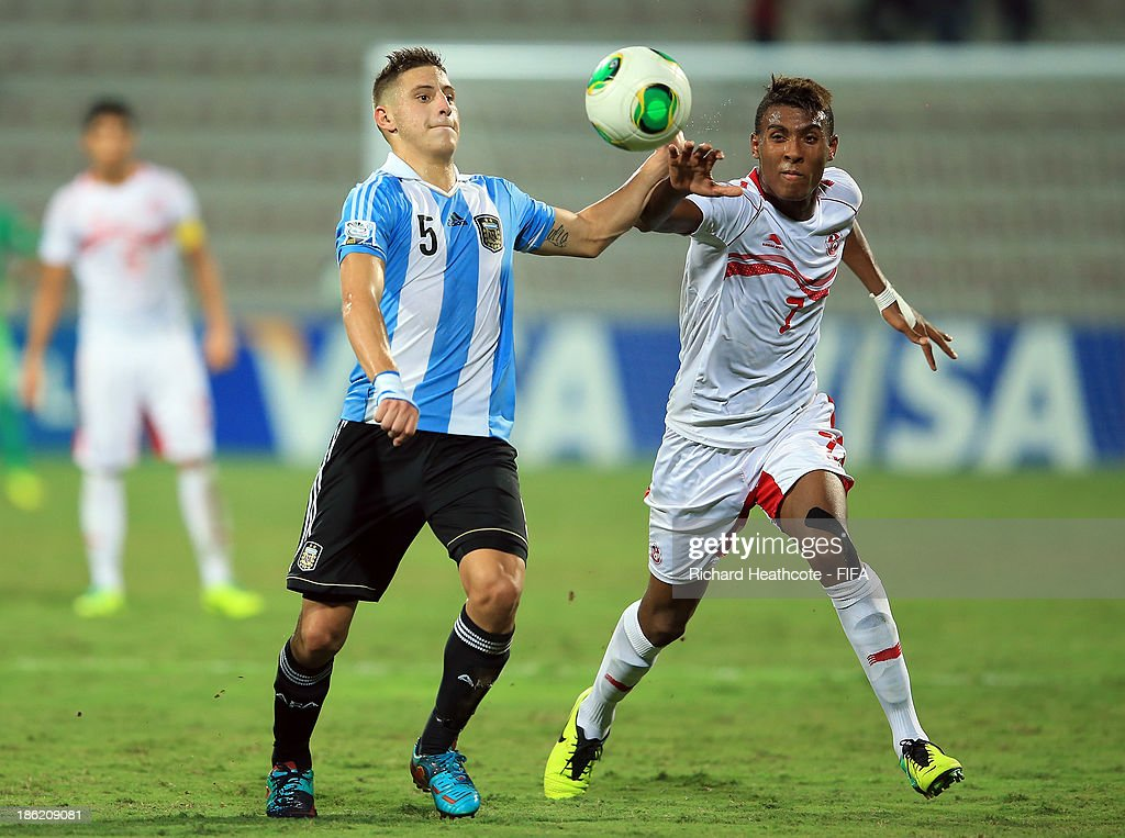 German Ferreyra of Argentina holds off Mouez Aboud of Tunisia during the FIFA U-17 World Cup UAE 2013 round of 16 match between Argentina and Tunisia at the Rashid Stadium on October 29, 2013 in Dubai, United Arab Emirates.