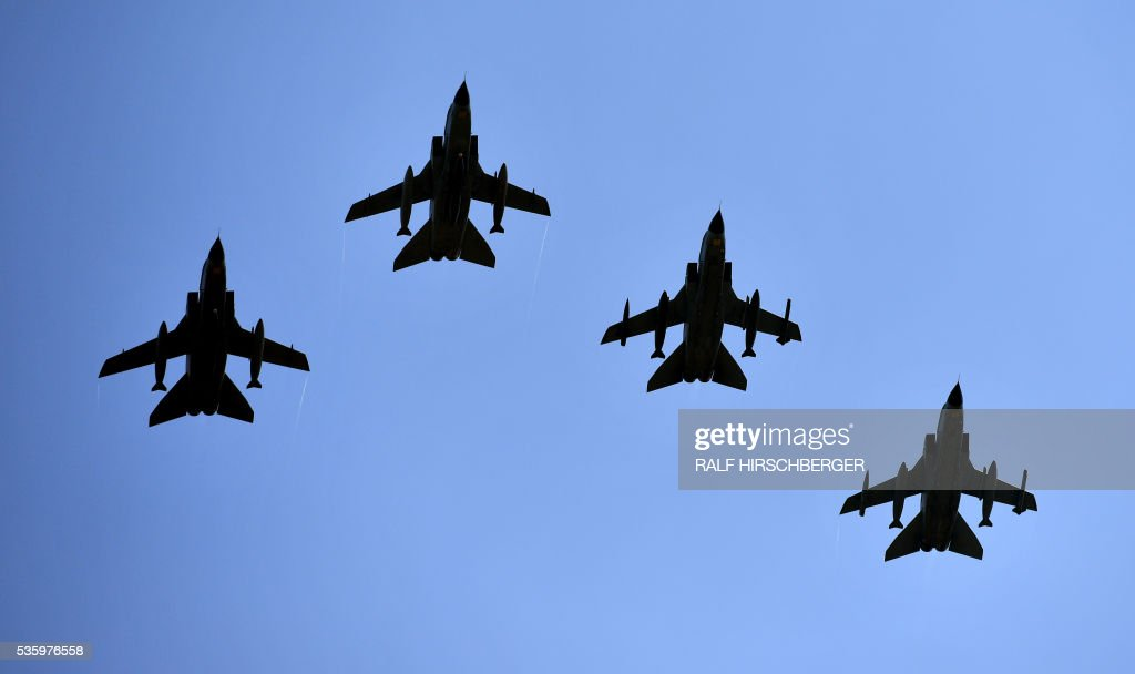 German fighters 'Tornado' fly over the International Aerospace Exhibition (ILA) in Schoenefeld on May 31, 2016. The Aerospace Exhibition at Schoenefeld Airport near Berlin takes place from June 1 till 4. / AFP / dpa / Ralf Hirschberger / Germany OUT