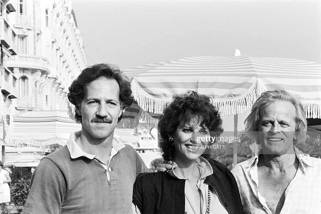 German film director Werner Herzog, Italian actress Claudia Cardinale and German actor Klaus Kinski pose during the photocall of 'Fitzcarraldo' during the 35th International Film Festival in Cannes, on May 21, 1982. AFP PHOTO RALPH GATTI