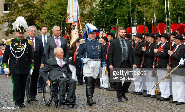 German Finance Minister Wolfgang Schaeuble accompanied by European Commission President JeanClaude Juncker and Thomas Strobl chairman of the regional...