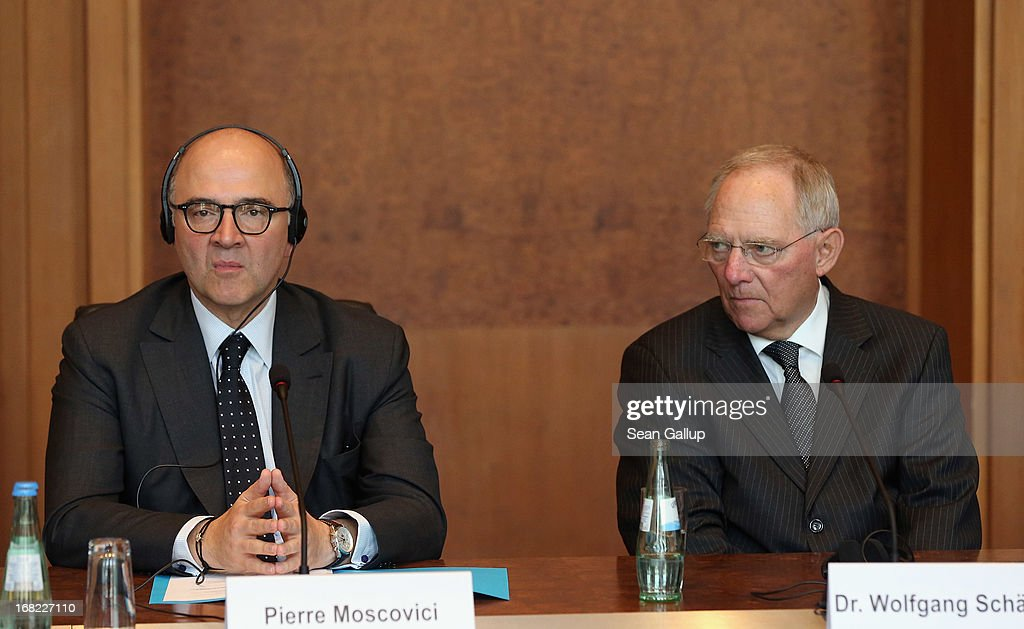German Finance Minister Wolfgang Schaeuble (R) and French Finance Minister <a gi-track='captionPersonalityLinkClicked' href=/galleries/search?phrase=Pierre+Moscovici&family=editorial&specificpeople=667029 ng-click='$event.stopPropagation()'>Pierre Moscovici</a> attend a discussion with students during events marking the 25th anniversary of the Franco-German Finance and Econimic Council on May 7, 2013 in Berlin, Germany. The Council was founded in 1988 to further not only economic relations between Germany and France but to create a further foundation for European economic stability.