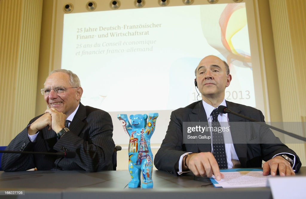 German Finance Minister Wolfgang Schaeuble (L) and French Finance Minister <a gi-track='captionPersonalityLinkClicked' href=/galleries/search?phrase=Pierre+Moscovici&family=editorial&specificpeople=667029 ng-click='$event.stopPropagation()'>Pierre Moscovici</a> arrive to speak to the media following events marking the 25th anniversary of the Franco-German Finance and Econimic Council on May 7, 2013 in Berlin, Germany. The Council was founded in 1988 to further not only economic relations between Germany and France but to create a further foundation for European economic stability.