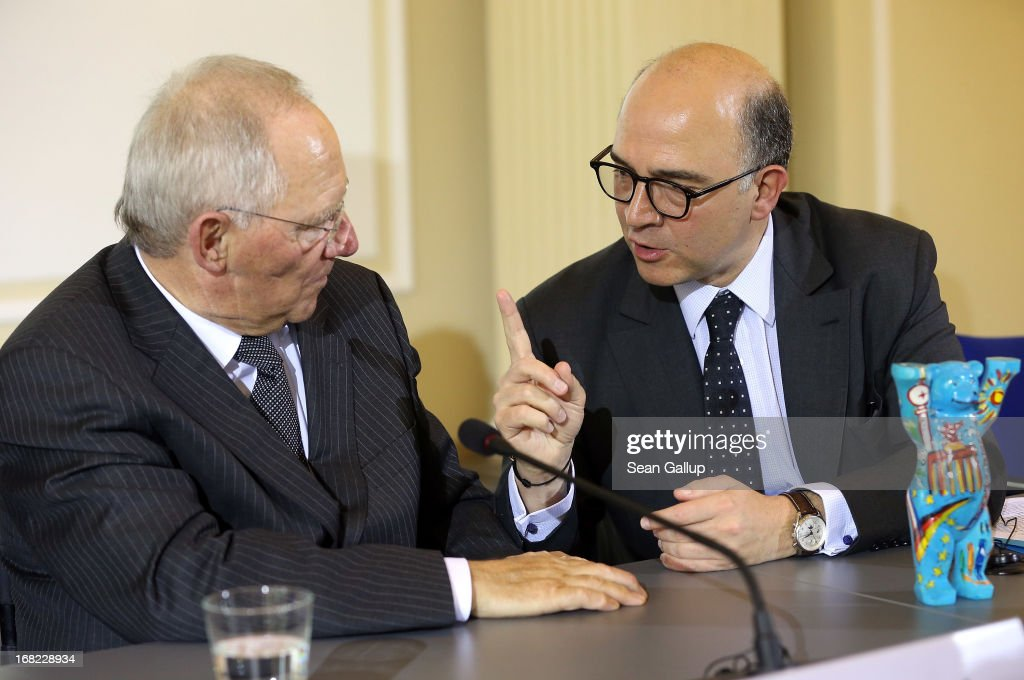 German Finance Minister Wolfgang Schaeuble (L) and French Finance Minister <a gi-track='captionPersonalityLinkClicked' href=/galleries/search?phrase=Pierre+Moscovici&family=editorial&specificpeople=667029 ng-click='$event.stopPropagation()'>Pierre Moscovici</a> chat after speaking to the media following events marking the 25th anniversary of the Franco-German Finance and Econimic Council on May 7, 2013 in Berlin, Germany. The Council was founded in 1988 to further not only economic relations between Germany and France but to create a further foundation for European economic stability.